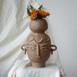 Ada ceramic vase with a face