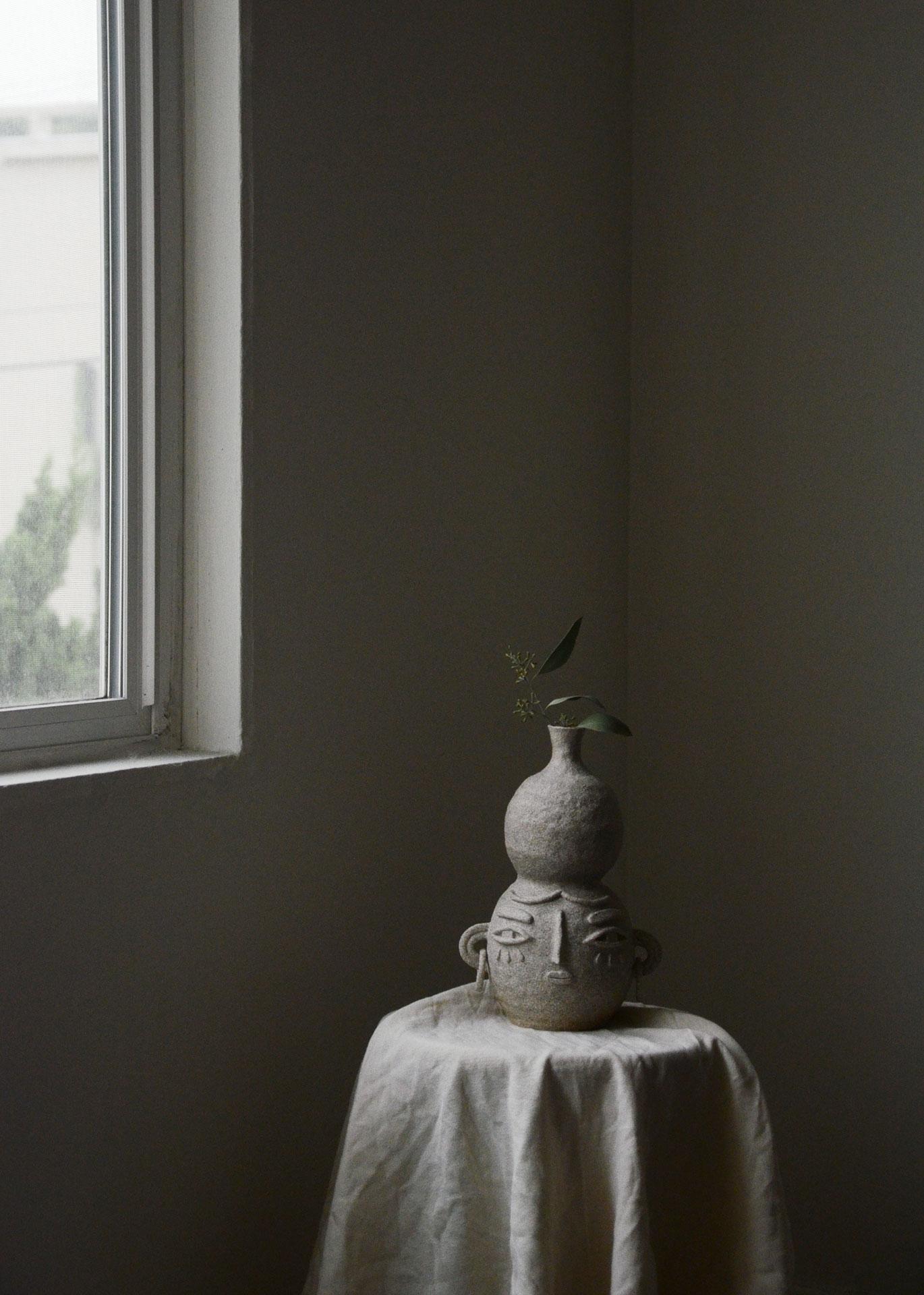 Ceramic vase with face
