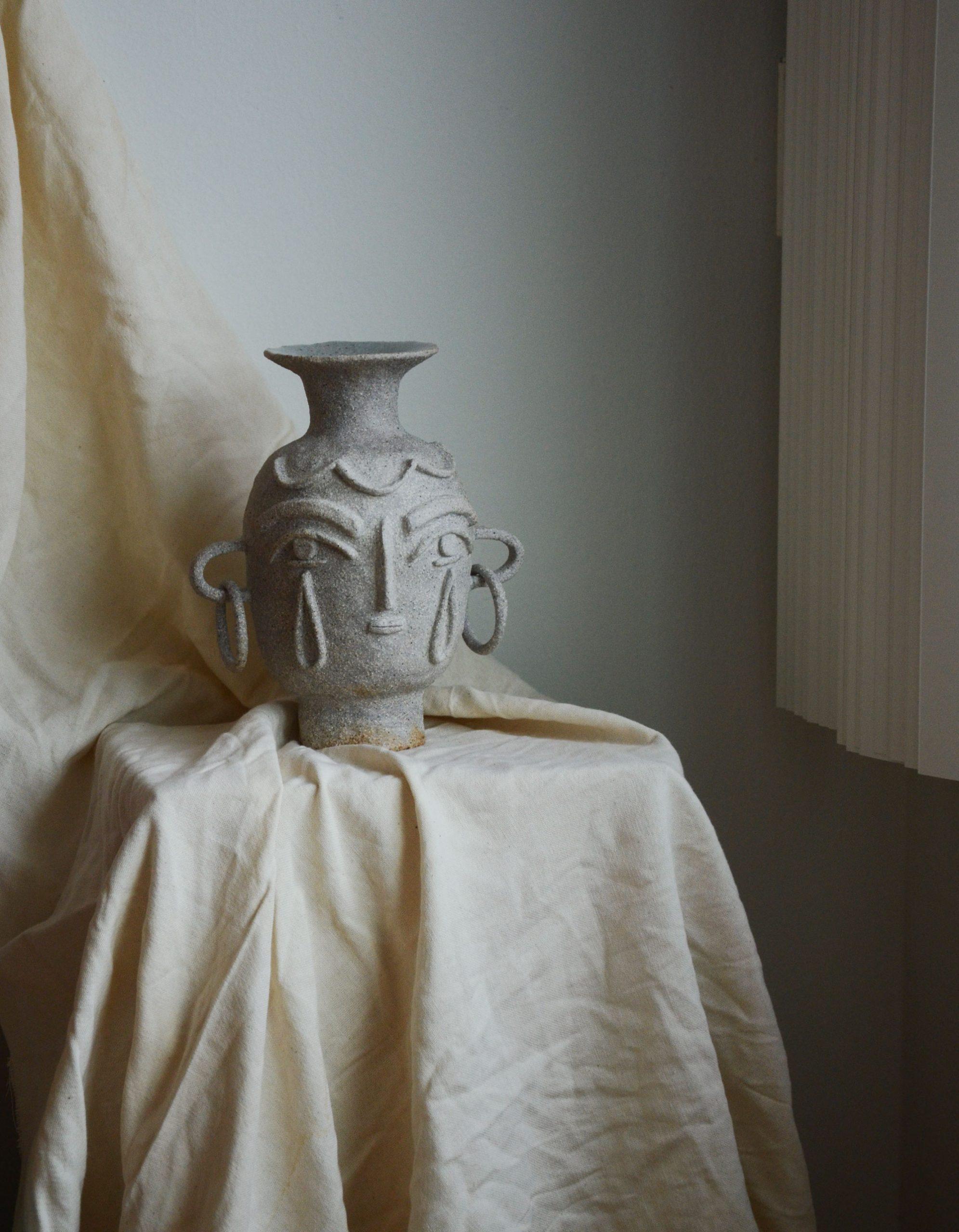 Ceramic vase head