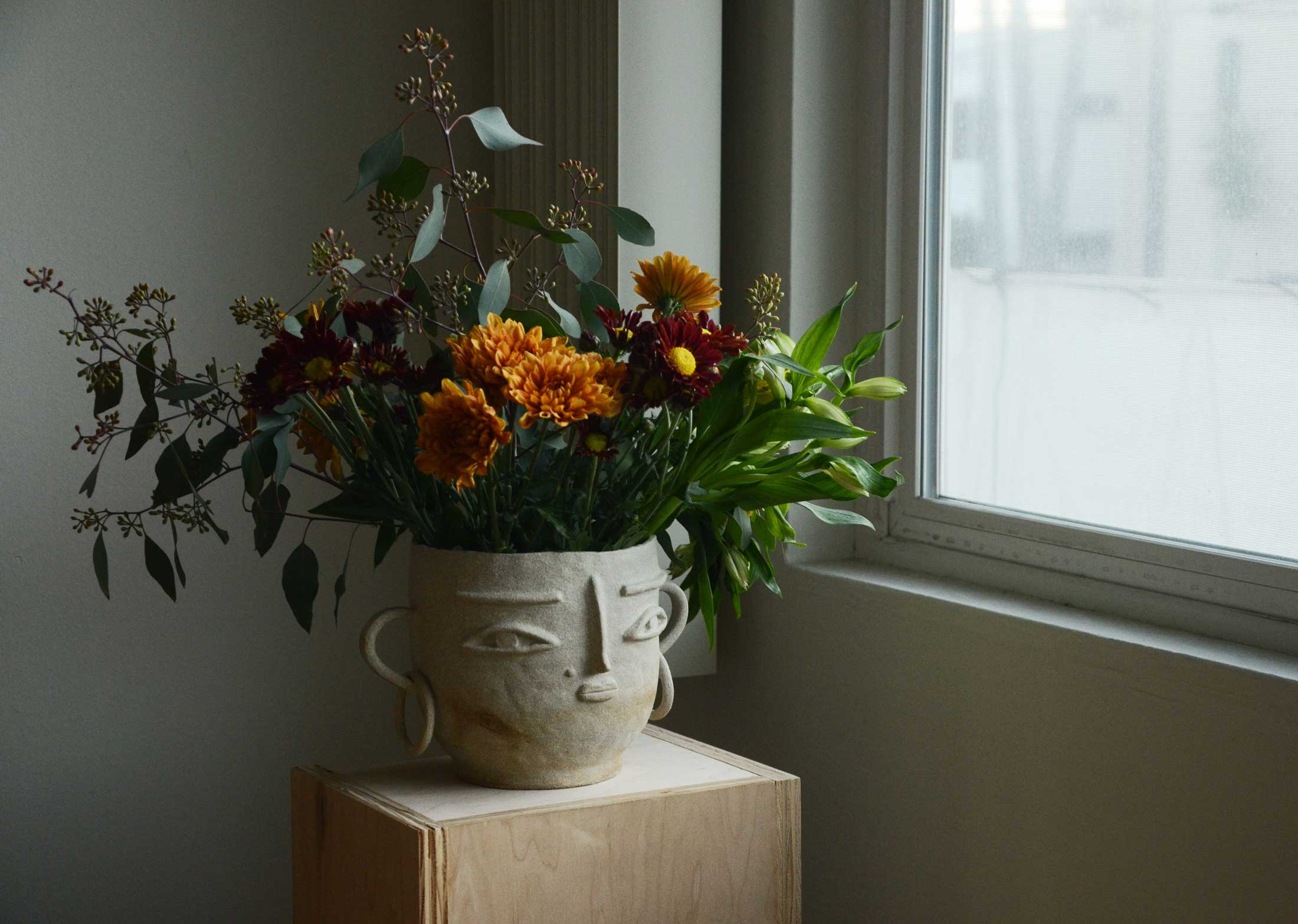 Flowers vase with face